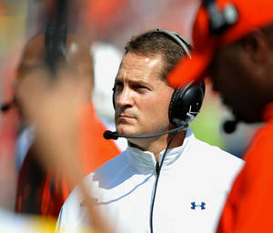 Photo -   Auburn coach Gene Chizik watches from the sideline during an NCAA college football game against Mississippi in Oxford, Miss., on Saturday, Oct. 13, 2012. (AP Photo/Oxford Eagle, Bruce Newman) MAGS OUT, NO SALES, MANDATORY CREDIT