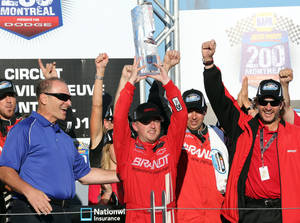 Photo -   Justin Allgaier, center, holds up the trophy as he celebrates in victory lane after winning the NASCAR Nationwide Series auto race Saturday, Aug. 18, 2012 at the Circuit Gilles Villeneuve in Montreal. (AP Photo/The Canadian Press, Tom Boland)