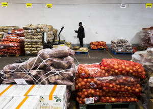 Photo - In this Thursday, Jan. 23, 2014, photo, vegetables are stacked in a  warehouse owned by Procacci Brothers, one of the nation's largest produce distributors, in Philadelphia. The Labor Department releases the Producer Price Index for January, on Wednesday, Feb. 19, 2014. (AP Photo/Matt Rourke)