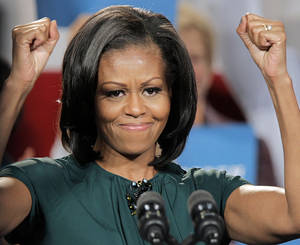 photo -   First lady Michelle Obama reacts to the cheers as she campaigns for her husband, President Barack Obama, at a rally at the Douglas County Fairgrounds in Castle Rock, Colo., Thursday, Oct. 11, 2012. (AP Photo/Ed Andrieski)
