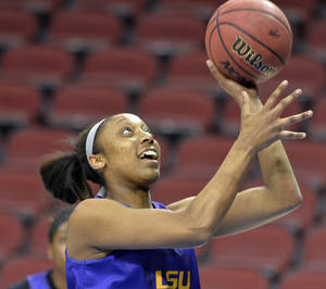 Photo - LSU's Shanece McKinney works on layup drills during practice at the NCAA college basketball tournament in Louisville, Ky., Saturday, March 29, 2014. LSU plays Louisville in a regional semifinal on Sunday. (AP Photo/Timothy D. Easley)