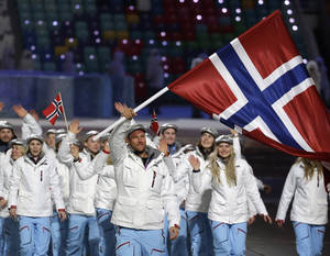 Photo - Aksel Lund Svindal of Norway carries the national flag as he leads the team during the opening ceremony of the 2014 Winter Olympics in Sochi, Russia, Friday, Feb. 7, 2014. (AP Photo/Mark Humphrey)