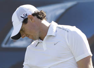 Photo - Rory McIlroy from Northern Ireland reacts on the 7th hole during the second round of Abu Dhabi Golf Championship in Abu Dhabi, United Arab Emirates, Friday, Jan. 18, 2013. (AP Photo/Kamran Jebreili)