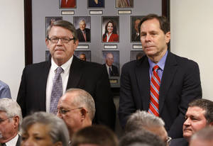 photo - Karl Springer, right, superintendent of Oklahoma City Public Schools, stood against a wall with others in the back of the room.  An overflow audience of about 75 people crammed into the conference room at the State Education Department  Monday, March 19, 2012.  to comment about the proposed grading system that would give all Oklahoma public schools an A through F grade designation.  Photo by Jim Beckel, The Oklahoman