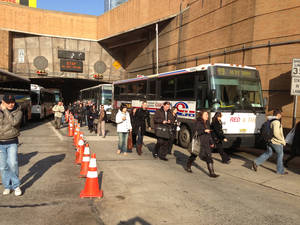 Photo -   Morning commuters exit the Lincoln Tunnel in New York, Monday, Nov. 12, 2012, after the tunnel was closed after two buses collided near the tunnel in New Jersey, injuring about 20 people. (AP Photo/Audrius Juskelis)