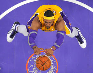 Photo - Los Angeles Lakers center Dwight Howard dunks during the first half of their NBA basketball game against the Milwaukee Bucks, Tuesday, Jan. 15, 2013, in Los Angeles. (AP Photo/Mark J. Terrill)