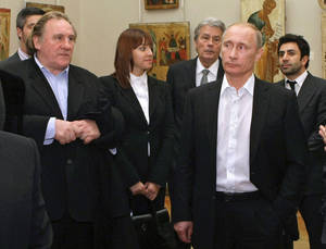 Photo - FILE - In this Saturday, Dec. 11, 2010 file photo Russian Prime Minister Vladimir Putin, right, and French actor Gerard Depardieu, left, attend the Russian Museum, in St. Petersburg. Gerard Depardieu, the French actor who has been sparring with his native country over taxes, has been granted Russian citizenship. A brief announcement on the Kremlin website said President Vladimir Putin signed the citizenship grant on Thursday Jan. 3, 2013. (AP Photo/RIA Novosti, Alexei Nikolsky, Pool)