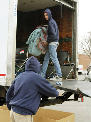 Photo - Movers pack office equipment and furniture onto a truck as city employees move from the administration building at 100 E First St. to the Hargove building. PHOTO BY PAUL HELLSTERN, THE OKLAHOMAN. <strong>PAUL HELLSTERN - OKLAHOMAN</strong>