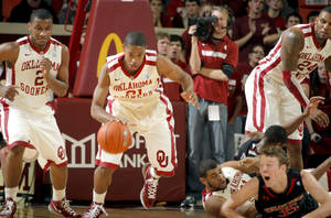 Photo - Oklahoma's Cameron Clark (21) drives up court during the men's college basketball game between the University of Oklahoma  and Texas Tech University of at the Lloyd Nobel Center in Norman, Okla., Tuesday, Jan. 17, 2012. Photo by Sarah Phipps, The Oklahoman