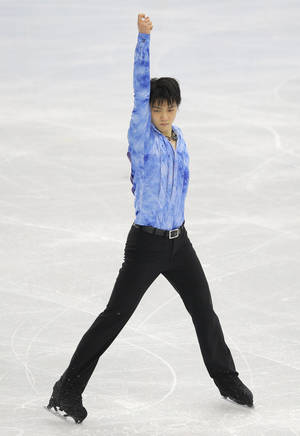 Photo - Yuzuru Hanyu of Japan competes in the men's short program figure skating competition at the Iceberg Skating Palace at the 2014 Winter Olympics, Thursday, Feb. 13, 2014, in Sochi, Russia. (AP Photo/Vadim Ghirda)