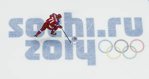 Photo - Russia forward Ilya Kovalchuk takes the puck to the goal during a shootout against Slovakia in overtime of a men's ice hockey game at the 2014 Winter Olympics, Sunday, Feb. 16, 2014, in Sochi, Russia. Kovalchuck scored the winning goal to give Russia the 1-0 win. (AP Photo/Julio Cortez )