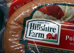 Photo - FILE - This Monday, Feb. 7, 2011, file photo shows Hillshire Farm products at Quality Market in Barre, Vt. Pilgrim's Pride on Tuesday, May 27, 2014 said it is offering to acquire meat producer Hillshire Brands in a deal worth about $5.58 billion. (AP Photo/Toby Talbot, File)