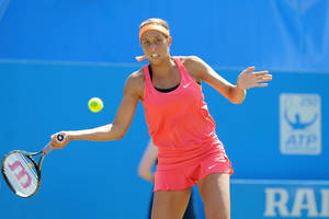 Photo - Madison Keys of the U.S. prepares to return to Britain's Heather Watson in their semifinal match at the Aegon International tennis tournament at Devonshire Park, Eastbourne, southern England, Friday June 20, 2014. (AP Photo/PA, Clive Gee) UNITED KINGDOM OUT  NO SALES  NO ARCHIVE