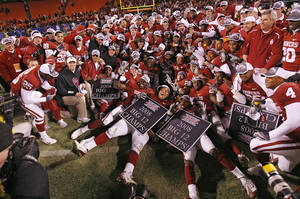 Photo - The Sooners pose for a team photo after winning the Big 12 Championship college football game between the University of Oklahoma Sooners (OU) and the University of Missouri Tigers (MU) on Saturday, Dec. 6, 2008, at Arrowhead Stadium in Kansas City, Mo.   PHOTO BY CHRIS LANDSBERGER/THE OKLAHOMAN
