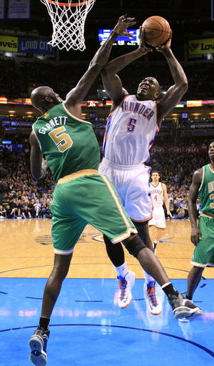 photo - Oklahoma City's Kendrick Perkins (5) shoots over Boston's Kevin Garnett (5) during the NBA game between the Oklahoma City Thunder and the Boston Celtics at the Chesapeake Energy Arena in Oklahoma City, Sunday, March 10, 2013. Photo by Sarah Phipps, The Oklahoman