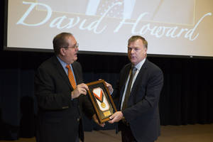 Photo -  Mike Woods, left, of Oklahoma State University's Division of Agricultural Sciences and Natural Resources presents the 2014 DASNR Champion award to David Howard on Tuesday at OSU's Stillwater campus. Photos provided by Todd Johnson  <strong>   -  Photo by Todd Johnson </strong>