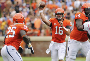 Photo -   Virginia quarterback Michael Rocco (16) passes to tailback Kevin Parks against Richmond during the first quarter of an NCAA college football game, Saturday, Sept. 1, 2012, in Charlottesville, Va. (AP Photo/News & Daily Advance, Sam O'Keefe)