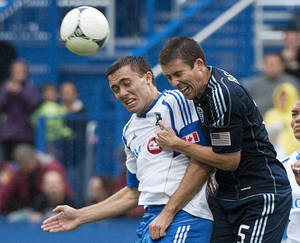 Photo -   Montreal Impact's Andrew Wenger, left, and Sporting Kansas City's Matt Besler go up for a head ball during second half MLS soccer action in Montreal, Saturday, Sept. 22, 2012. (AP Photo/The Canadian Press, Graham Hughes)
