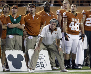 photo - Texas coach Mack Brown stands next to symbols used for play calling during the first quarter of an NCAA college football game against New Mexico, Saturday, Sept. 8, 2012, in Austin, Texas. (AP Photo/Eric Gay) ORG XMIT: TXEG119