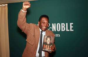 "Photo - Brazilian soccer star Pele makes an appearance at Barnes & Noble to signs copies of his book ""Why Soccer Matters"" on Tuesday, April 1, 2014, in New York. (Photo by Luiz Ribeiro/Invision/AP)"