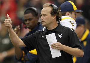 Photo - West Virginia head coach Dana Holgorsen signals his players in the second half of an NCAA football game against Maryland in College Park, Md., Saturday, Sept. 17, 2011. West Virginia won 37-31. (AP Photo/Patrick Semansky) ORG XMIT: MDPS112