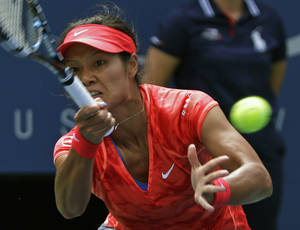 Photo - Li Na, of China, returns a shot against Sofia Arvidsson, of Sweden, during the second round of the 2013 U.S. Open tennis tournament, Wednesday, Aug. 28, 2013, in New York. (AP Photo/Kathy Willens)