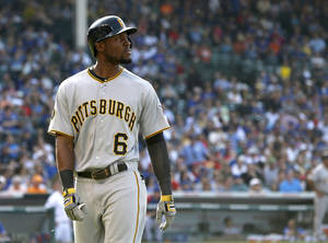 Photo - Representing the tying run, Pittsburgh Pirates' Starling Marte looks back out into right field after his long fly ball was caught by Chicago Cubs right fielder Nate Schierholtz, near the warning track during the seventh inning of a baseball game Friday, June 20, 2014, in Chicago. (AP Photo/Charles Rex Arbogast)