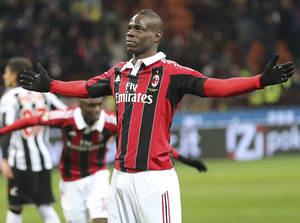 Photo - AC Milan forward Mario Balotelli celebrates after scoring during the Serie A soccer match between AC Milan and Udinese at the San Siro stadium in Milan, Italy, Sunday, Feb. 3, 2013. (AP Photo/Antonio Calanni)