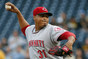 Photo - Cincinnati Reds starting pitcher Alfredo Simon (31) delivers during the first inning of a baseball game against the Pittsburgh Pirates in Pittsburgh, Wednesday, June 18, 2014. (AP Photo/Gene J. Puskar)