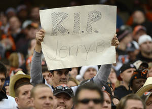 Photo - A fan holds a sign for Dallas Cowboys player Jerry Brown who was killed in an automobile accident during an NFL football game against the Cincinnati Bengals, Sunday, Dec. 9, 2012, in Cincinnati. (AP Photo/Michael Keating)