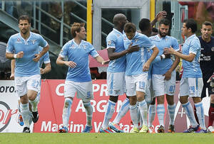 Photo - Lazio's Antonio Candreva, third from right, celebrates with teammates after scoring during a Serie A soccer match between Livorno and Lazio, in Leghorn, Italy, Sunday, April 27, 2014. (AP Photo/Francesco Speranza )