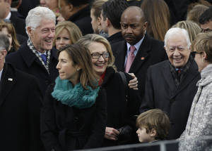 Photo - Secretary of State Hillary Clinton and former President Bill Clinton speak with former President Jimmy Carter at the ceremonial swearing-in for President Barack Obama at the U.S. Capitol during the 57th Presidential Inauguration in Washington, Monday, Jan. 21, 2013. (AP Photo/Pablo Martinez Monsivais)