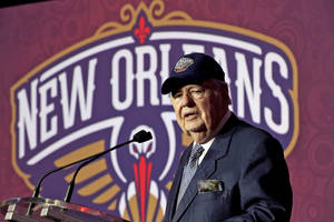 Photo - FILE - In this Jan. 24, 2013 file photo, New Orleans Hornets NBA team owner Tom Benson speaks at a news conference announcing that the NBA basketball team's name will change from the Hornets to the Pelicans, in New Orleans. One of the people most responsible for bringing NBA All-Stars back to the Big Easy this weekend is an 86-year-old man who wasn't that into basketball for much of his life. He is Tom Benson. And in New Orleans, NBA fans and community leaders are grateful the Pelicans owner finally came around. (AP Photo/Gerald Herbert, File)