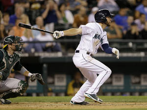 Photo - Seattle Mariners' Nick Franklin drives in a pair of runs against the Oakland Athletics in the eighth inning of a baseball game Saturday, June 22, 2013, in Seattle. (AP Photo/Elaine Thompson)