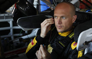Photo - Driver Josh Wise prepares for practice as he sit in his car for Sunday's Aaron's 499 NASCAR auto race at Talladega Superspeedway on Friday, May 2, 2014, in Talladega, Ala. (AP Images Photo/Butch Dill)