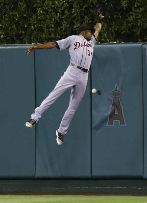 Photo -   Detroit Tigers center fielder Austin Jackson can't get a glove on a triple by Los Angeles Angels' Kendrys Morales during the sixth inning of a baseball game in Anaheim, Calif., Friday, Sept. 7, 2012. (AP Photo/Chris Carlson)
