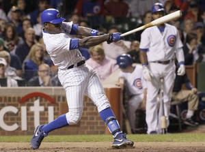 photo -   Chicago Cubs' Alfonso Soriano hits a two-run home run during the sixth inning of a baseball game against the Cincinnati Reds in Chicago, Wednesday, Sept. 19, 2012. (AP Photo/Nam Y. Huh)