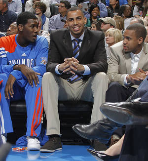 Photo - Oklahoma City Thunder shooting guard Thabo Sefolosha (2) sits on the bench with Oklahoma City Thunder point guard Eric Maynor (6) and Oklahoma City Thunder point guard Royal Ivey (7) during the NBA basketball game between the Oklahoma City Thunder and the Phoenix Suns at the Chesapeake Energy Arena on Wednesday, March 7, 2012 in Oklahoma City, Okla. Photo by Chris Landsberger, The Oklahoman <strong>CHRIS LANDSBERGER</strong>
