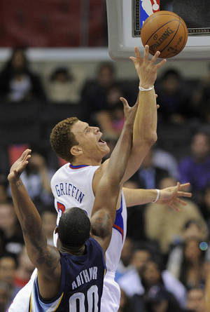 Photo - Los Angeles Clippers forward Blake Griffin, puts up a shot during the first half of the NBA basketball game against Memphis on Wednesday. The Clippers won, 110-103. (AP Photo/Mark J. Terrill)