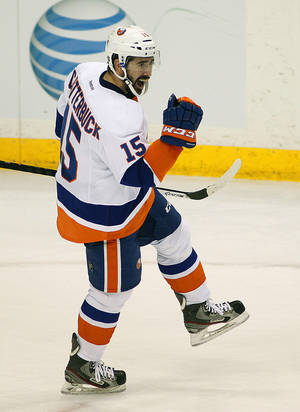 Photo - New York Islanders forward Cal Clutterbuck celebrates his goal against his former team the Minnesota Wild during the second period of their NHL hockey game, Sunday, Dec. 29, 2013, in St. Paul, Minn. (AP Photo/Andy Clayton-King)