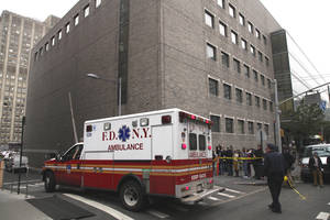 "photo -   FILE - In this Wednesday, Oct. 31, 2012 file photo, an ambulance departs Bellevue Hospital in New York where patients were being evacuated. One of two New York hospitals that had to evacuate patients at the height of Superstorm Sandy is set to begin reopening. In a statement on its website, officials at NYU Langone Medical Center say ""almost all"" practices are scheduled to restart Monday Nov. 5, 2012 though some doctors will see patients at alternate locations. At Bellevue Hospital Center an official there said the hospital could be out of commission for at least two more weeks. (AP Photo/Mark Lennihan)"