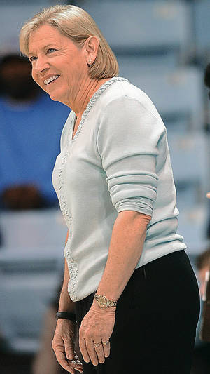 Photo - North Carolina coach Sylvia Hatchell smiles during an NCAA college basketball game against Florida State on Thursday, Jan. 31, 2013, in Chapel Hill, N.C. (AP Photo/The Herald-Sun, Bernard Thomas)