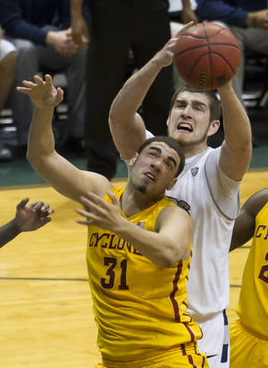Photo - Iowa State forward Georges Niang (31) and Akron center Pat Forsythe, top, battle for a rebound in the first half of an NCAA college basketball game at the Diamond Head Classic, Monday, Dec. 23, 2013, in Honolulu. (AP Photo/Eugene Tanner)