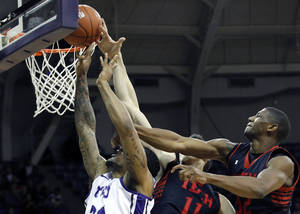 photo - TCU&#039;s Adrick McKinney (24) goes to the basket against Texas Tech&#039;s Dejan Kravic (11) and Jordan Tolbert, right, during an NCAA college basketball game Saturday, Jan. 5, 2013, in Fort Worth, Texas. Texas Tech defeated TCU 62-53. (AP Photo/The Fort Worth Star-Telegram, Joyce Marshall) MAGS OUT; (FORT WORTH WEEKLY, 360 WEST); INTERNET OUT