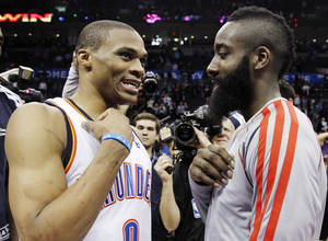 Photo - Oklahoma City Thunder guard Russell Westbrook (0) and Houston Rockets guard James Harden, right, talk after their NBA basketball game in Oklahoma City, Wednesday, Nov. 28, 2012. Oklahoma City won 120-98. (AP Photo/Sue Ogrocki) ORG XMIT: OKSO109