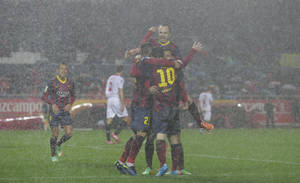 Photo - Barcelona's Lionel Messi celebrates with teammates after scoring against Sevilla during their La Liga soccer match at the Sanchez Pizjuan stadium, in Seville, Spain on Sunday, Feb. 9, 2014. (AP Photo/Miguel Angel Morenatti)