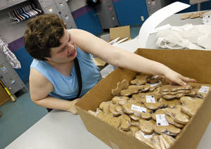 Photo - Nicole S. works on packaging Buddy Biscuits dog treats on Aug. 6 in the vocational services building.  Photo by Nate Billings, The Oklahoman <strong>NATE BILLINGS -   NATE BILLINGS  </strong>