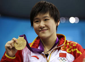 Photo - FILE - In this July 31, 2012 file photo, China's Ye Shiwen poses with her gold medal for the women's 200-meter individual medley swimming final at the Aquatics Centre in the Olympic Park during the 2012 Summer Olympics in London. The 2012 London Games champion in the women's 200- and 400-meter medleys registered late August, 2014 at Beijing's prestigious Tsinghua University under a government program waiving the grueling entrance exam for outstanding athletes. (AP Photo/Matt Slocum, File)