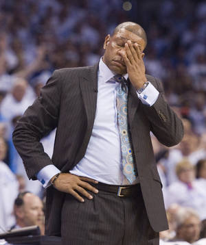Photo - Los Angeles Clippers' head coach Doc Rivers can't believe the foul committed by the Clippers late in the first quarter during the first half in Game 5 of the NBA Western Conference semi-finals at the Chesapeake Arena in Oklahoma City on Tuesday, May 13, 2014. (AP Photo/The Orange County Register, Michael Goulding) ///ADDITIONAL INFO.01.clippers.0514.mg- 05/13/2014  - MICHAEL GOULDING, ORANGE COUNTY REGISTER -  Clippers v Thunder Game 5 Western Conference semi-finals