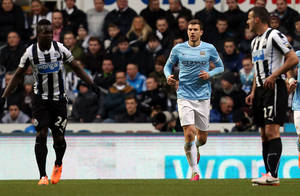 Photo - Manchester City's Edin Dzeko, center, celebrates his goal during their English Premier League soccer match against Newcastle United at St James' Park, Newcastle, England, Sunday, Jan. 12, 2014. (AP Photo/Scott Heppell)